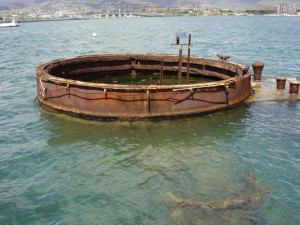 USS Arizona _ Gun Turret Pearl Harbor, Hawaii - August 12, 2007: Gun turret number three of the USS Arizona at Pearl Harbor, Hawaii. You can still smell the oil seeping from the ship.