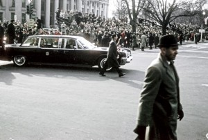 Washington, D. C. - January 20, 1965: Presidential limo turns onto Pennsylvania Ave. from NW 15 Street. Lady Bird seated next to the President.