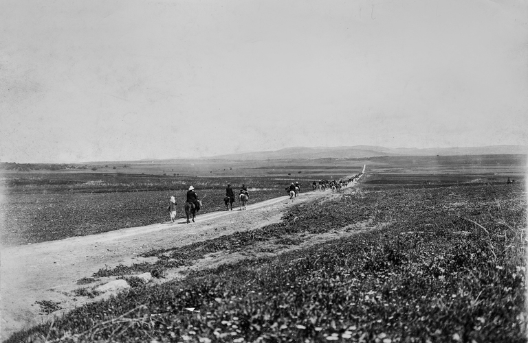 "Armageddon Israel - April 18, 1888: Jewish pilgrims on the Plain of Esdraelon on their way to Harosheth. Megiddo to the northwest is the site of the ""end of days"" battle described in the Book of Revelation. Date is approximate; true date unknown."