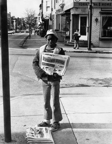 York, Pennsylvania (November 6, 1966). A newspaper boy and girl (across the street) selling the Sunday News.
