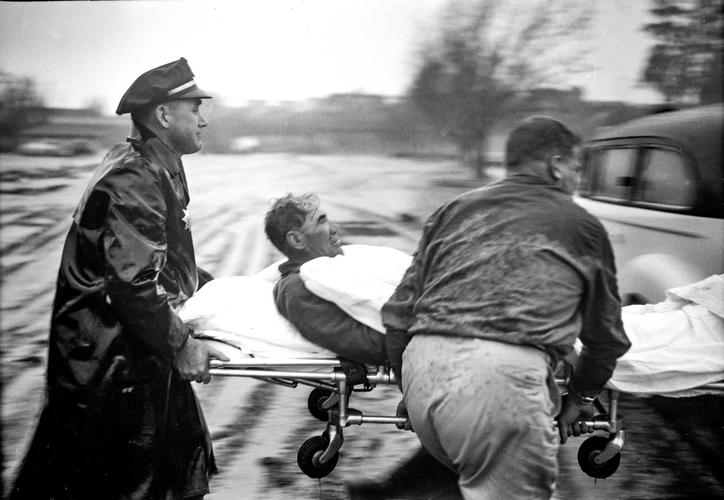 Police and rescuers transport a man on a stretcher to a waiting ambulance. Santa Cruz, California