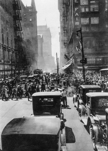 Crowded streets of downtown Chicago. The Fair Store is seen at the right. c.1924