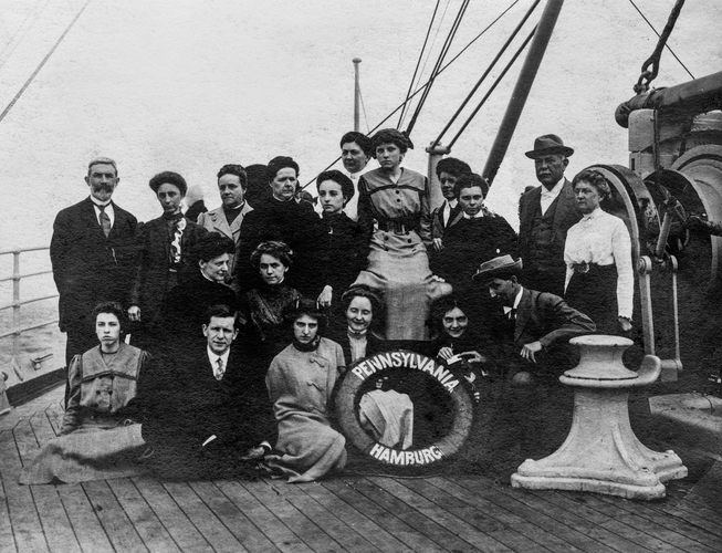 Seemingly first class passengers. A sense of what life aboard the Titanic must have been like. See: https://en.wikipedia.org/wiki/SS_Pennsylvania_(1896). Date is approximate; true date unknown.