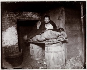 """Peddler Who Slept in the Cellar of 11 Ludlow Street"" (1892) Jacob Riis"